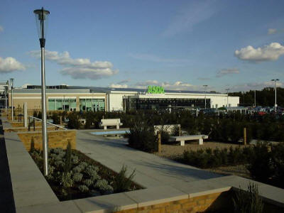 This is a picture of part of our newly built (in 2003) Water Gardens shopping complex. The new complex increases the size of our town centre (The High) and now Harlow can boast of a new Asda, Matalan, T K Max, Sports Centre and several eating places. Ample multi level parking is available.